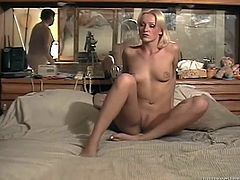 Go wild as you watch this blonde babe, with natural boobs and a shaved cunt, while she has sex with a nasty dude over a bed. She's a dirty girl!