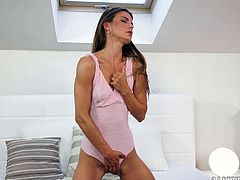 Go crazy as you watch this long haired brunette, with small breasts and a shaved pussy, while she touches herself enthusiastically.