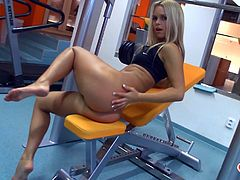 Sexy Sabrina Blond: don't you just want to fuck her all night long? I know I would, and she knows it too, posing in front of the mirror in the gym. She shows off her body and can't stop touching it all over. Looks like we're not the only ones who want her. She's so hot she wants to fuck herself!