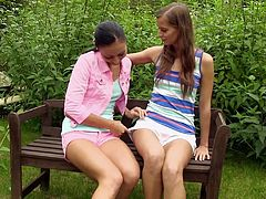 Entertain yourself by watching these babes, with natural breasts wearing shorts, while they touch, lick and finger each other's coochies ardently.