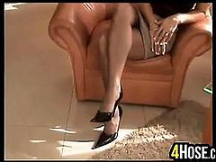 Blonde MILF Giving A Footjob