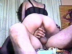 Insatiable dark-haired whore wearing black lingerie dildos her snatch and ardently sucks erected dick. Then she bounces on that tool in a cowgirl pose.