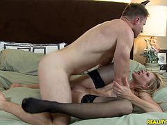The gorgeous MILF Desi Dalton wears sexy black stockings as she gets her asshole fingered and takes a big cock up her sweet pussy.