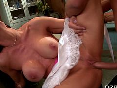 Well stacked brunette Vanilla Deville rubs her muff while getting fucked on the table