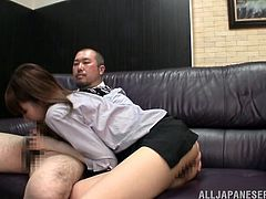 Watch this hot scene where the sexy Japanese hottie Minami Hirahar is masturbated by one of her coworkers before she jerks him off in the office.