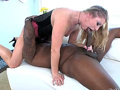 Watch this hardcore scene where the slutty blonde Aurora Snow ends up with a mouthful of semen after being fucked by a monster black cock.