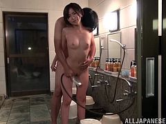 Nasty Japanese chick and her man are having fun in the public shower. They stroke each other's wet bodies, then the bitch kneels in front of the guy and sucks his wang.