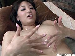 Press play on this hot scene and get a load of Shion Utsunomi's huge natural breasts as they're oiled up before she titty fucks a guy.