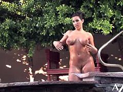 Brianna Jordan looks hot in her bikini, but she looks hotter without! She plays with her pussy by the pool.