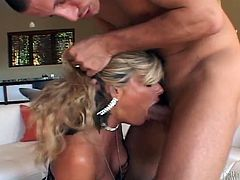 Witness this video where a blonde lady, with big fake knockers wearing sexy lingerie, while she gets fucked hard after serving a yummy blowjob.