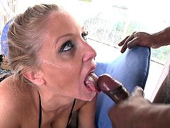 Julia Ann was on her wild and hot lingerie getting ready to be fucked. She gets banged by a black huge cock and gets a facial cumshot.