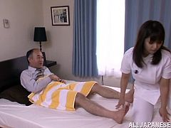 Press play to watch this Asian brunette, with natural boobs wearing her nurse uniform, while she sucks a big cock to a dirty man over a bed.
