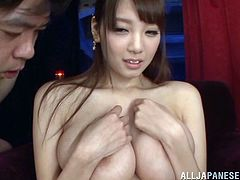 Have fun watching this Asian brunette, with a nice ass wearing nylon stockings, while she touches herself and dirty fellows masturbate next to her.