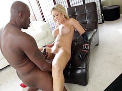 Click to watch this blonde pornstar, with a nice ass wearing leather clothes, while she gets fucked hard by a black dude and moans loudly.