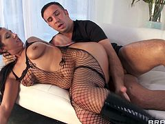 Brunette cougar in fishnet stockings thrilled as he oils her hot ass and removes her thong then gives him a blowjob before getting hammered hardcore