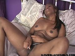 Ebony slut Kellya strips and shows her big natural tits for the cam. Then she spreads her legs wide apart and begins to rub her throbbing snatch with a dildo.