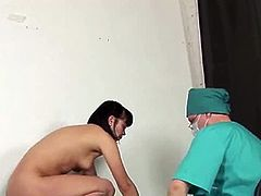 This perverted doctor slides his fingers down this brunette babe's throat before he examines her pussy. No wonder she is afraid of a doctor who does that to her.