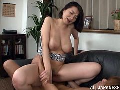 Mio Takahashi is cleaning the kitchen and washing some dishes but gets to be fucked. She gives the cock a hardcore blowjob and gets fucked doggy style.