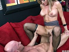 Gorgeous cougar cowgirl in high heels aroused as he fondles her big tits then gives a blowjob before getting screwed missionary