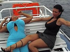 Make sure you check out these ladies' huge natural tits in this hot lesbian scene where they have fun on a boat out in the sea.