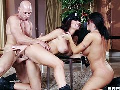 A gorgeous pornstar with long dark hair, nice big tits and a fantastic body enjoys a hardcore threesome fuck in her living room.