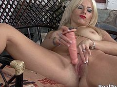 This gorgeous blonde strips down to nothing and shows her perfect body while she toys her delicious pussy with a big dildo.