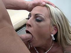 Buxom MILF gives her gynecologist a sloppy blowjob