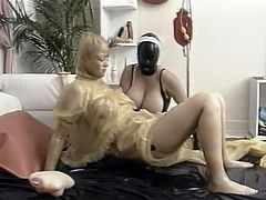 Two kinky chicks in latex outfit lick each other snatches in 69 style