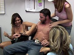 A handsome guy with short dark hair and an awesome body enjoys a hardcore gangbang in his office. See him cum right now.