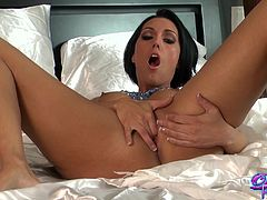 Beautiful brunette with big tits in blue thong showcase her hot ass before fingering her shaved pussy in a close up shoot