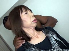 Mature Asian chick gets banged in her wet pussy with a black huge cock in an amateur porn scene. She takes the cock in her mouth like a pro and rides it big time.