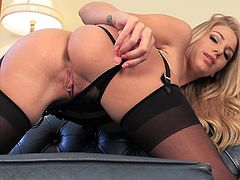 She's blonde and boy, she is craving for sexual satisfaction. Danielle wears her very sexy lingerie and gives us a peek of what she has underneath her sexy black panties. The blonde knows how to raise men cock so she reveals her big boobs and then her sweet, shaved cunt. Enjoy what she has to offer!