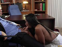 Codi is a hot black whore with incredible large breasts. She gets inside her bosses office and spills some coffee on his dick. She rubs it a while pretending she wants to clean his pants, but his wife comes in and sees them. She threatens to leave him so Codi needs to make him feel better. She shows him her big boobs, then give him a blowjob.