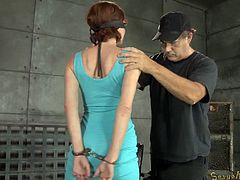A slutty milf has recently been brought down in the basement. It´s time to play dirty, so her hands are tied with shackles, limiting her from moving freely. The bitch with short hair is also blindfolded. Click to see the busty slut down on knees sucking a guy´s dick.