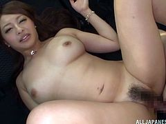 Pretty Japanese girl, wearing shorts and thong, shows her butt to a man and drives him crazy with a blowjob in a car. After that they fuck in the missionary pose.