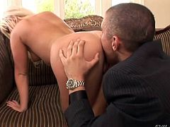 Holly Fox is a sexy blonde that uses her skilled hands to give these two guys handjobs before she lets them double penetrate her.
