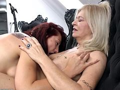 Ilana and Karissa are two hot bitches who decided it's time to play. They got on their black couch and start kissing each-other. The blonde whore rubs and kisses her partner's boobs while she moans like a thirsty bitch. Karissa removes her friend's pants, gets over her and licks her big sexy nipples. Will they get what they want?