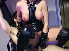 Wendy Taylor, wearing a leather outfit, is having fun with a man in a basement. Wendy dominates the stud, whips his butt and then takes a ride on his hard cock.