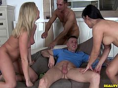 Roseline Love and her BF are having fun with their neighbours indoors. The women favour the dudes with blowjobs, then let them lick their cunts and fuck them in the cowgirl pose.