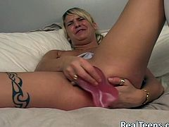 Amateur blond solo model with natural tits, piercing and tattoo wears miniskirt and enjoys masturbation time with toys inserted in cunt