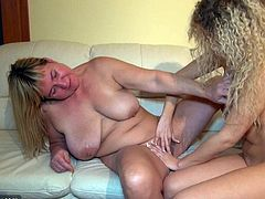 Curly-haired blonde lesbian is getting naughty with her mature neighbour indoors. The women pet each other, then slam each other's vaginas with dildos.
