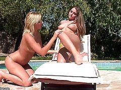 Blonde Eve Smile and Nelly Sullivan satisfy their sexual desires together in girl-on-girl action