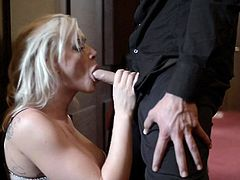 This elegant babe has a huge pair of knocker that she sticks in her man's face. He motorboats her and sucks her boobs. This makes her so horny that she has no choice to suck his cock as he enjoys his tea.