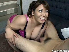 Horny Japanese mom Mizuki Ann, wearing panties and a bra, shows her large natural boobs to a man. Then she rubs his boner devotedly and takes it in her mouth.