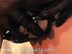 Dominica locks herself into her chastity belt with plugs on orders from her dominant