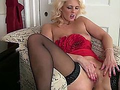 Tall blonde bombshell of a milf lifts her dress to tease her hungry pussy through lace panties and massages her sensitive clit and juicy wet hole