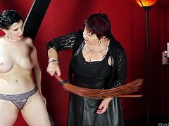 This mean mistress is going to show you the basics of sensual flogging by giving a demonstration. Watch as she uses the whip on her slave. First her tits get hit, and then she gets her butt flogged by the mistress Nerine.