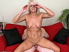horny mature couple makes love on the couch.