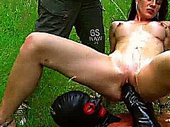 Busty brunette mifl enjoys a deep fist fucking orgasm as shes showered in piss at the local park