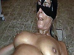 Busty blond amateur slut brutally fisted and fucked with a huge dildo on the floor of a public toilet
